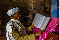 Ethiopian Orthodox priest praying, Bete Maryam (St. Mary's Church), one of 11 rock hewn churches in Lalibela, Ethiopia.
