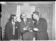 30/05/1960<br /> 05/30/1960<br /> 30 May 1960<br /> W.D. & H.O. Wills and Gael Linn press conference on new collaboration at the Hibernian Hotel Dublin. Image shows (l-r): Louis Marcus, Film Director; A. Price, Advertising Manager, W.D. & H.O. Wills and Riobard Mac Gabhrain, Manager Gael Linn.