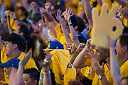 Fans celebrate the Golden State Warriors becoming NBA Champions after beating the Cleveland Cavaliers in Game 5 of the NBA Finals at Oracle Arena in Oakland, Calif., on June 12, 2017. (Stan Olszewski/Special to S.F. Examiner)