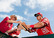 Ji-Man Choi signs autographs before the Angels' preseason game against the Chicago Cubs at Angel Stadium Sunday.<br /> <br /> <br /> ///ADDITIONAL INFO:   <br /> <br /> angels.0404.kjs  ---  Photo by KEVIN SULLIVAN / Orange County Register  --  4/3/16<br /> <br /> The Los Angeles Angels take on the Chicago Cubs at Angel Stadium during a preseason game at Angel Stadium Sunday.<br /> <br /> <br />  4/3/16