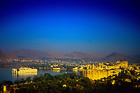 Lake Palace Hotel (on Lake Pichola) and City Palace (on right), Udaipur, Rajasthan, India