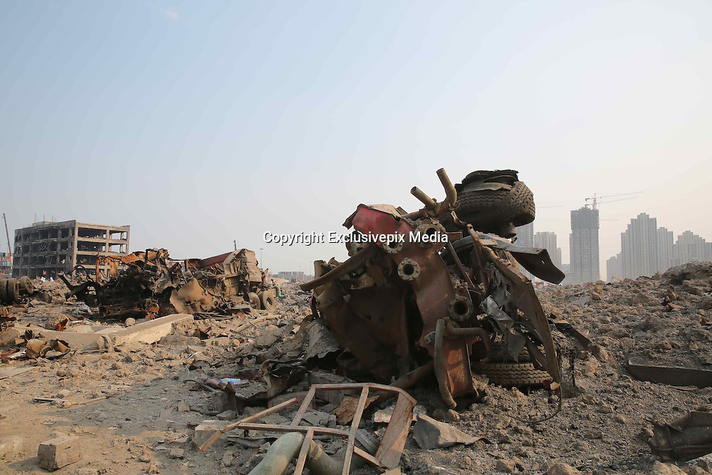 TIANJIN, CHINA - AUGUST 24: (CHINA OUT) <br /> <br /> Chemical-defence Soldiers Detect Toxic Substance<br /> <br /> A burnt fire engine is seen at Tianjin blasts scene on August 26, 2015 in Tianjin, China. The death toll from the Tianjin warehouse explosions two weeks ago has risen to 139, and 34 others remain missing, rescue authorities said on Wednesday.<br /> ©Exclusivepix Media
