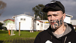"""EXCLUSIVE: Mark Cropp wants to get off the dole, get a job and put food on the table for his family. But there's one small problem - a giant tattoo saying """"DEVAST8"""" that covers half of his face is proving off-putting for prospective employers. 13 Jul 2017 Pictured: Mark Cropp. Photo credit: NZ Herald / MEGA TheMegaAgency.com +1 888 505 6342"""