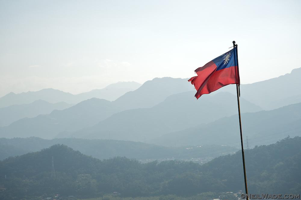 A torn Taiwan flag waves in the breeze in Taipei, Taiwan.