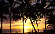 Couple in ammock at sunset, Maui, Hawaii<br />