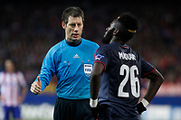 Referee Wolfgang Stark talks to Olympiacos´s Masuaku during Champions League soccer match between Atletico de Madrid and Olympiacos at Vicente Calderon stadium in Madrid, Spain. November 26, 2014. (ALTERPHOTOS/Victor Blanco)