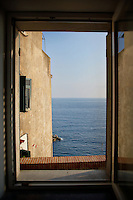 Looking out a window at the sea in Riomaggiore, Italy.
