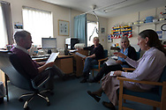GPs Dr David Binnie and Dr Jan Brooks (right) with nurse Beverley Reid and administrator Rhona Robinson, pictured during a meeting in the medical practice on the the Inner Hebridean island of Colonsay on Scotland's west coast.  The island is in the council area of Argyll and Bute and has an area of 4,074 hectares (15.7 sq mi). Aligned on a south-west to north-east axis, it measures 8 miles (13 km) in length and reaches 3 miles (4.8 km) at its widest point, in 2019 it had a permanent population of 136 adults and children.