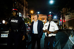Toronto mayor John Tory and police chief Mark Saunders speaks to press following a mass casualty event in Toronto, ON, Canada, on Sunday, July 22, 2018. A young woman has been killed and 13 others injured in a shooting incident in Toronto, Canadian police say. The Sunday night shooting happened in the Danforth and Logan avenues area. The gunman died in an exchange of fire. Among those injured is a young girl, described as in a critical condition. Police are appealing for witnesses. Photo by Christopher Katsarov/ABACAPRESS.COM