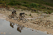 Kevin Evans and Max Knox of team Fedgroup Itec crossing a river during stage 2 of the 2014 Absa Cape Epic Mountain Bike stage race from Arabella Wines in Robertson, South Africa on the 25 March 2014<br /> <br /> Photo by Greg Beadle/Cape Epic/SPORTZPICS