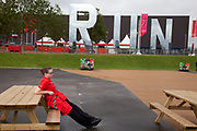 London 2012 Olympic Park in Stratford, East London. The word RUN is spelt out in large scale mirror letters, one of a few big sculptures on the site.