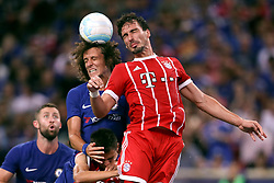 July 25, 2017 - Singapore, Singapore - Chelsea's DAVID LUIZ (C) in action against Bayern Munich's MATS HUMMELS (R) during their International Champions Cup match in Singapore. Bayern Munich won 3:2. (Credit Image: © Yong Teck/Action Images via ZUMA Press)