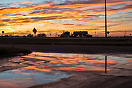 Fracking industry truck in  the Midland Texas in the Permain Basin at sunrise.