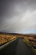 """Snow clouds loom over the R230 from Glencolumkille to Ardara Road in Donegal, Ireland, January 2015. Copyright Dave Walsh This mage can be licensed via Millennium Images. Contact me for more details, or email mail@milim.com For prints, contact me, or click """"add to cart"""" to some standard print options."""