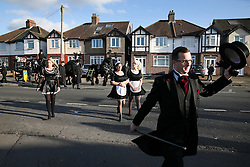 © Licensed to London News Pictures. 09/12/2015. London, UK. Three women dressed in maids uniforms lead the funeral procession as a carriage carrying the coffin travels to the service. The funeral of former brothel keeper Cynthia Payne takes place at the South London Crematorium.  In 1980 Cynthia Payne was sentenced to 18 months for running a brothel at her house on Ambleside Avenue in Streatham. It was alleged, at the time, that judges and Members of Parliament were visitors to her establishment. Photo credit: Peter Macdiarmid/LNP