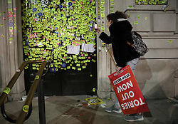 Stickers on the Cabinet Office door on Whitehall left by anti-Brexit campaigners after they took part in the People's Vote March in London.