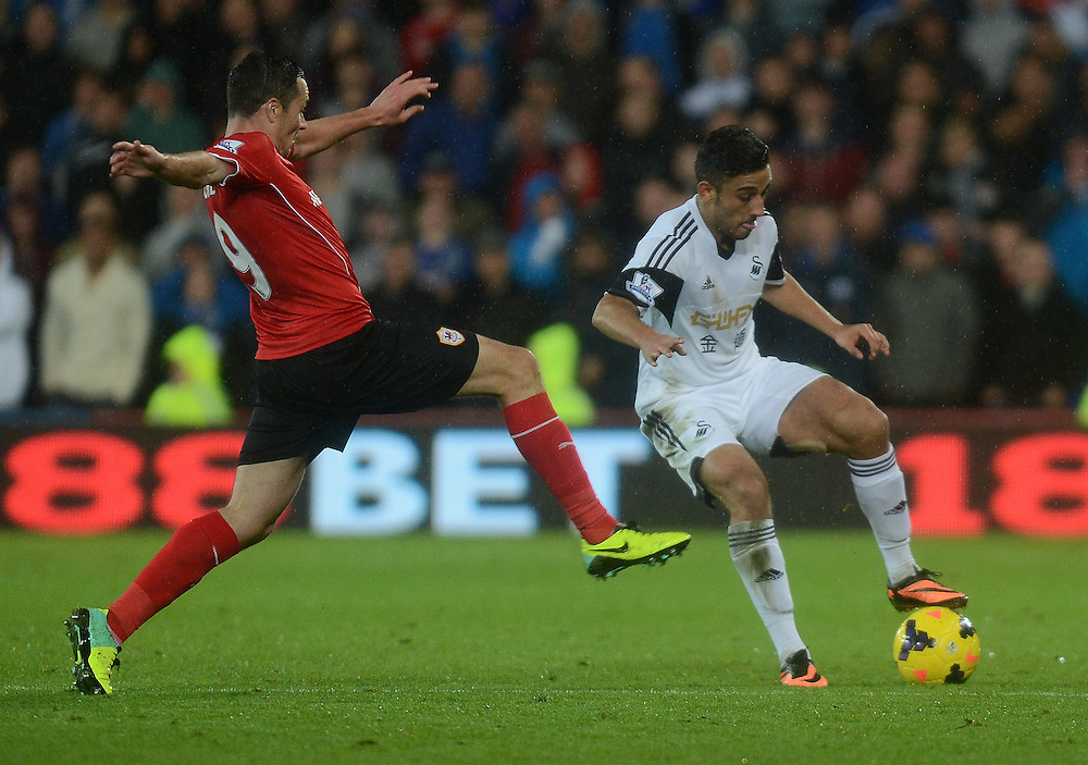 Cardiff City's Don Cowie closes down Swansea City's Neil Taylor<br /> <br /> Photo by Ian Cook/CameraSport<br /> <br /> Football - Barclays Premiership - Cardiff City v Swansea City - Sunday 3rd November 2013 - Cardiff City Stadium - Cardiff<br /> <br /> © CameraSport - 43 Linden Ave. Countesthorpe. Leicester. England. LE8 5PG - Tel: +44 (0) 116 277 4147 - admin@camerasport.com - www.camerasport.com