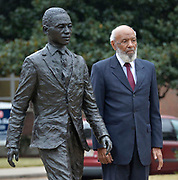 James Meredith, the first African American to attend Ole Miss, is on campus shooting a documentary. Meredith is seen standing and sitting by the statue of himself on the campus of the University of Mississippi right behind the Lyceum building. Meredith has never been a fan of the statute and even asked it be removed and destroyed when it was first unvieled.  Photo copyright ©Suzi Altman