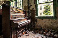Merrill 1934 Piano Company, Boston. Abandoned upright piano inside an old poor house in upstate NY.