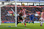 Joe Allen of Stoke City (4) tries to keep the ball in play. Premier league match, Stoke City v Leicester City at the Bet365 Stadium in Stoke on Trent, Staffs on Saturday 4th November 2017.<br /> pic by Chris Stading, Andrew Orchard sports photography.