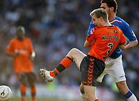 Christian Kalvenes Dundee Utd challenges with Rangers' Carlos Cuellar in the CIS Cup Final 16/03/08