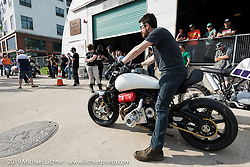 Brian Case, Co-founder and Design Director at MOTUS Motorcycles on the custom Motus V4 they built for the Handbuilt Motorcycle Show. Austin, TX. April 12, 2015.  Photography ©2015 Michael Lichter.