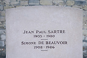 head stone of the grave of Sartre and Simone de Beauvoir in Cemetery Montparnasse in Paris