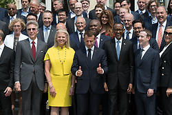 """Virginia Rometty, Emmanuel Macron, Paul Kagame and Mark Zuckerberg doing a family picture during the """"Tech for Good"""" summit over lunch with tech companies CEOs at the Elysee Palace, Paris, France, on May 23, 2018. Photo by Jacques Witt/pool/ABACAPRESS.COM"""