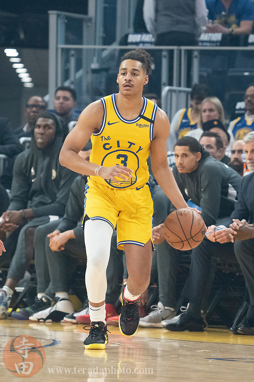 February 27, 2020; San Francisco, California, USA; Golden State Warriors guard Jordan Poole (3) dribbles the basketball during the first quarter against the Los Angeles Lakers at Chase Center.