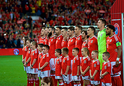 CARDIFF, WALES - Monday, October 9, 2017: Wales players stand for the national anthem before the 2018 FIFA World Cup Qualifying Group D match between Wales and Republic of Ireland at the Cardiff City Stadium. Aaron Ramsey, Chris Gunter, Joe Ledley, Hal Robson-Kanu, Tom Lawrence, Ben Davies, Andy King, James Chester, goalkeeper Wayne Hennessey, captain Ashley Williams (Pic by Paul Greenwood/Propaganda)