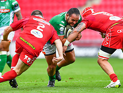 Epalahame Faiva of Benetton Treviso is tackled by Blade Thomson and Ken Owens of Scarlets<br /> <br /> Photographer Craig Thomas/Replay Images<br /> <br /> Guinness PRO14 Round 3 - Scarlets v Benetton Treviso - Saturday 15th September 2018 - Parc Y Scarlets - Llanelli<br /> <br /> World Copyright © Replay Images . All rights reserved. info@replayimages.co.uk - http://replayimages.co.uk