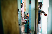 Sabrine and her daughter in their home in Heisa Island