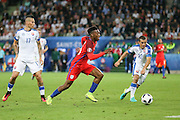 England Forward Daniel Sturridge attacks the Slovakia goal during the Euro 2016 Group B match between Slovakia and England at Stade Geoffroy Guichard, Saint-Etienne, France on 20 June 2016. Photo by Phil Duncan.