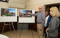 Campaign Executive Committee members John Walker and Sandy Brallier with Pastor Paula Gile (in back) show renderings for construction project at the Congregational Church and Parish Hall in downtown Laconia.   (Karen Bobotas/for the Laconia Daily Sun)
