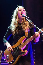 © Licensed to London News Pictures. 09/12/2013. London, UK.   Haim performing live at The Forum. In this picture - Este Haim.Haim is an American indie rock band consists of sisters Este Haim (bass/vocals), Danielle Haim (guitar/vocals) and Alana Haim (guitar/vocals/keyboards) with drummer Dash Huttong<br /> <br /> Haim were nominated in the Brand New for 2013 category in the 2013 MTV Music Awards, and won the Sound of 2013 category in the BBC Sound of 2013 awards. <br /> <br /> Photo credit : Richard Isaac/LNP