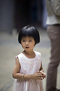 A child at the Thien Hau Pagoda, Ho Chi Minh City (formerly Saigon), Vietnam