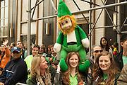A woman with a large stuffed leprechaun.