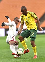 South Africa: Johannesburg: Bafana Bafana player Kamohelo Mokotjo battle for the ball with Seychelles player Colin Bibi during the Africa Cup Of Nations qualifiers at FNB stadium, Gauteng.<br />Picture: Itumeleng English/African News Agency (ANA)