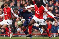 Photo: Daniel Hambury, Digitalsport<br /> Arsenal v Portsmouth.<br /> FA Barclays Premiership.<br /> 05/03/2005.<br /> Portsmouth's Yakubu gets between Arsenal's Gael Clichy L and Kolo Toure