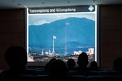 THEMENBILD - Die demilitarisierte Zone (DMZ) ist eine entmilitarisierte Zone. Sie teilt die Koreanische Halbinsel in Nord- und Südkorea und wurde nach dem drei Jahre dauernden Koreakrieg im Jahre 1953 eingerichtet. Die DMZ ist 248 Kilometer lang und ungefähr vier Kilometer breit. In ihrer Mitte verläuft die Militärische Demarkationslinie (MDL), die Grenze zwischen Nord- und Südkorea. Die DMZ wird von der aus Vertretern beider Seiten bestehenden Waffenstillstandskommission MAC (von engl. Military Armistice Commission) verwaltet. Das Betreten der DMZ ohne Genehmigung der Waffenstillstandskommission ist beiden Seiten grundsätzlich untersagt. Hier im Bild Sicherheitsunterweisung im Camp Bonifas zum Betreten der Joint Security Area (JSA), Flaggen in Taesongdong und Gijungdon. Die nordkoreanische Flagge über Kijŏng-dong (Gijungdon). Mit 160 m Höhe ist dies der vierthöchste Flaggenmast der Welt, die Flagge allein wiegt 270 kg. Aufgenommen am 28. Februar 2018 // The Korean Demilitarized Zone (DMZ) is a strip of land running across the Korean Peninsula. It is established by the provisions of the Korean Armistice Agreement to serve as a buffer zone between the Democratic People's Republic of Korea (North Korea) and the Republic of Korea (South Korea). The demilitarized zone (DMZ) is a border barrier that divides the Korean Peninsula roughly in half. It was created by agreement between North Korea, China and the United Nations in 1953. The DMZ is 250 kilometres (160 miles) long, and about 4 kilometres (2.5 miles) wide. In the Picture. Safety briefing at Camp Bonifas to enter the Joint Security Area (JSA) . DMZ on 28th February 2018. EXPA Pictures © 2018, PhotoCredit: EXPA/ Johann Groder