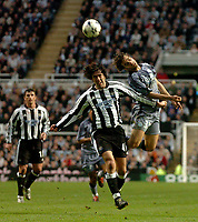 Photo. Glyn Thomas.Digitalsport<br /> Newcastle United v Olympique de Marseille. <br /> UEFA Cup Semi Final, First Leg. 22/04/2004.<br /> Marseille's Matthieu Flamini (R) fights an aerial battle for possession with Hugo Viana (C) as Aaron Hughes looks on.