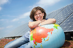 Happy young woman globe balloon smiling