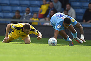 Coventry City defender Jordan Willis (4) dives after a loose ballduring the EFL Sky Bet League 1 match between Oxford United and Coventry City at the Kassam Stadium, Oxford, England on 9 September 2018.