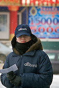 Moscow, Russia, 19/03/2005..Citibank staff canvass pedestrians for custom  outside the bank's new Novy Arbat branch in freezing temperatures and intermiittent blizzards.
