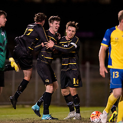 BRISBANE, AUSTRALIA - AUGUST 26: Declan Smith celebrates scoring a goal with Alex Janovsky and Byron Sinnerton of Moreton Bay during the NPL Queensland Senior Men's Semi Final match between Brisbane Strikers and Moreton Bay Jets at Perry Park on August 26, 2017 in Brisbane, Australia. (Photo by Patrick Kearney)
