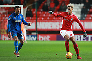 Charlton Athletic attacker Lyle Taylor (9) dribbling and taking on AFC Wimbledon midfielder Tom Soares (19) during the EFL Sky Bet League 1 match between Charlton Athletic and AFC Wimbledon at The Valley, London, England on 15 December 2018.