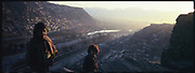 Girls stand on a hillside on Kabul which was occupied thousands of displaced war refugees coming from Pakistan.