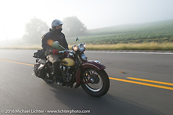 After his HD VL suffered a catastrophic failure, Jason Sims rides a 1939 Harley-Davidson Knucklehead from Carl's Cycles in the fog at the beginning of Stage 8 of the Motorcycle Cannonball Cross-Country Endurance Run, which on this day ran from Junction City, KS to Burlington, CO., USA. Saturday, September 13, 2014.  Photography ©2014 Michael Lichter.