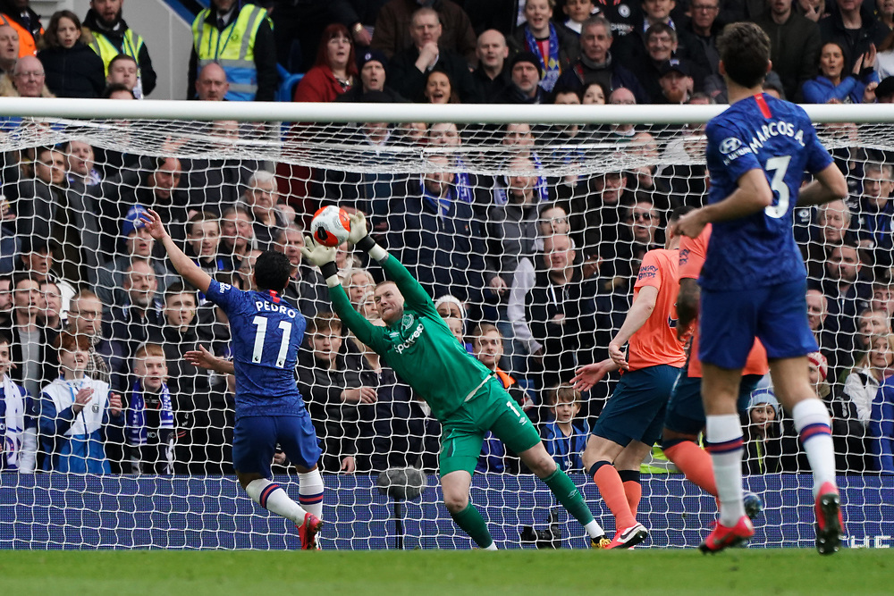 Everton's Jordan Pickford makes a save against Chelsea's Pedro<br /> <br /> Photographer Stephanie Meek/CameraSport<br /> <br /> The Premier League - Chelsea v Everton - Sunday 8th March 2020 - Stamford Bridge - London<br /> <br /> World Copyright © 2020 CameraSport. All rights reserved. 43 Linden Ave. Countesthorpe. Leicester. England. LE8 5PG - Tel: +44 (0) 116 277 4147 - admin@camerasport.com - www.camerasport.com