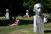 Frieze Sculpture 2017 opens to the public on July 5th 2017 in the English Gardens in Regents Park, London, England, United Kingdom. This is London's largest showcase of major outdoor works by leading artists and galleries, presenting a free outdoor exhibition for London and its international visitors throughout the summer months. Thomas J Price, Numen Shifting Votive One, Two and Three 2016.